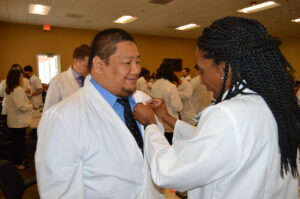 Student receiving a pin